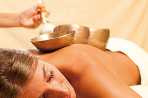 woman-singing-bowl-massage
