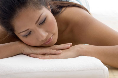 woman-enjoying-massage-treatment