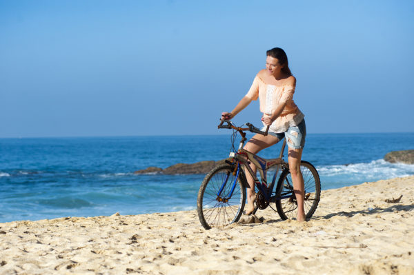 girl-on-the-beach-on-bicycle